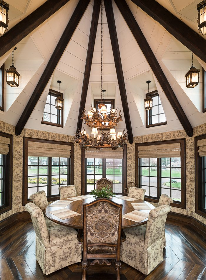 Tudor dining room with circular wood ceiling and wooden chandelier.