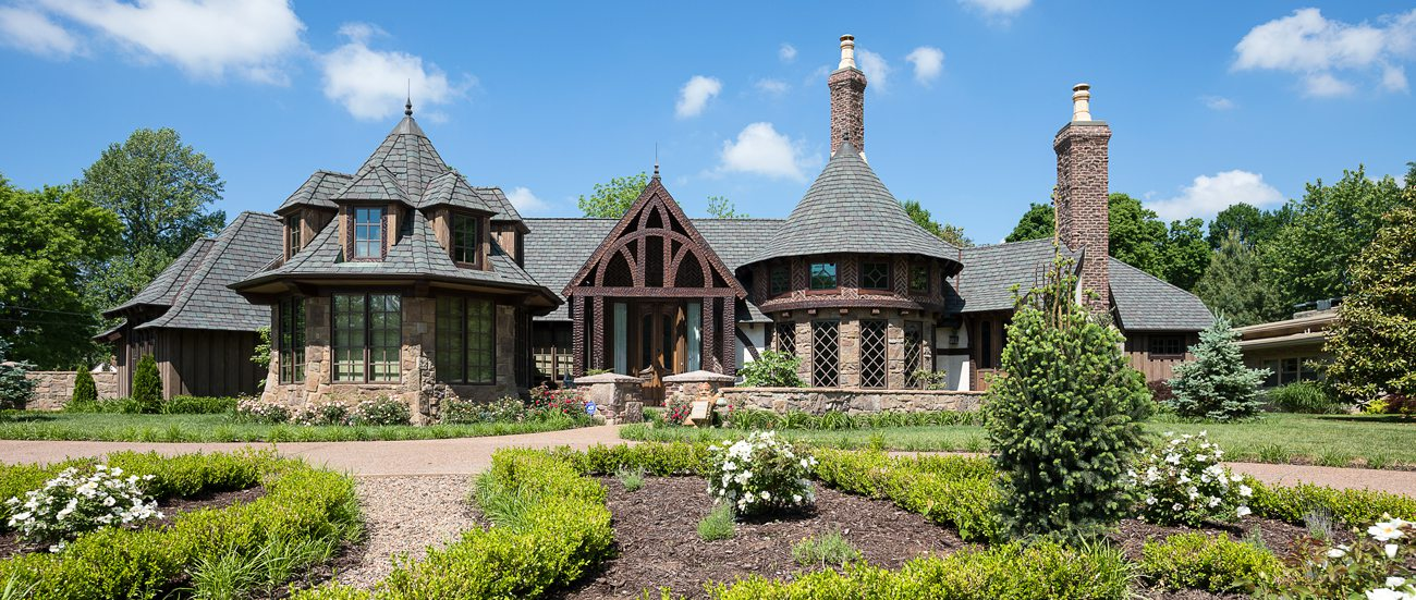 Tudor style Harry Potter home with beautiful landscaping.