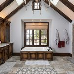 Slider Thumbnail: Tudor style master bath with skylights and wooden fixtures.