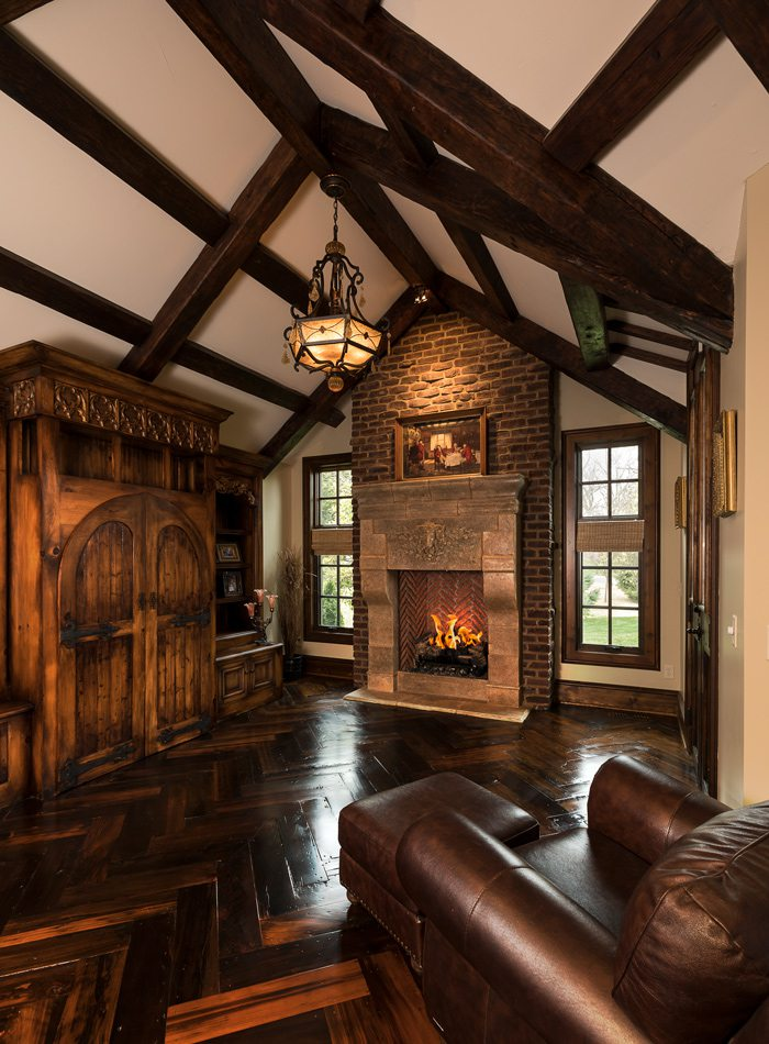 Tudor style office with Rumford fireplace and Cyprus floors.