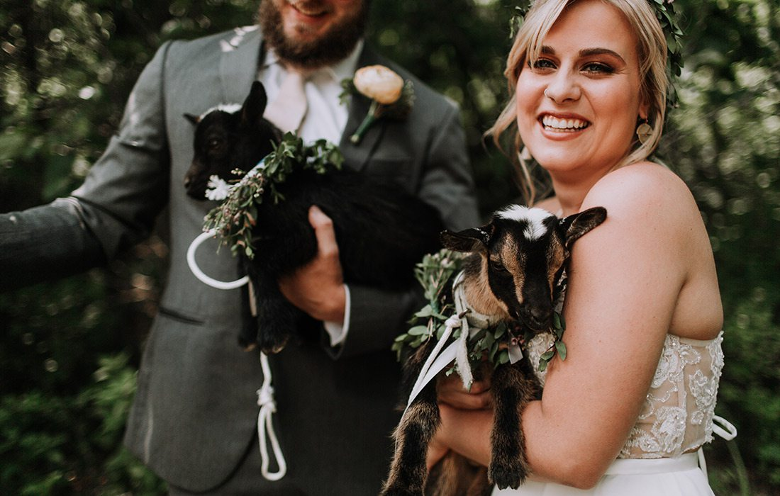 Ryan Kopas & Shai Voelker with baby goats on their wedding day