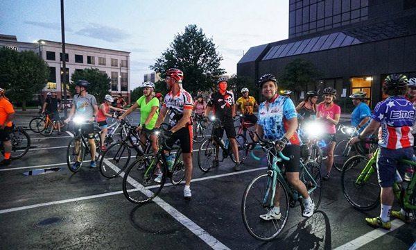 SBC Moonlight Bike riders in parking lot.