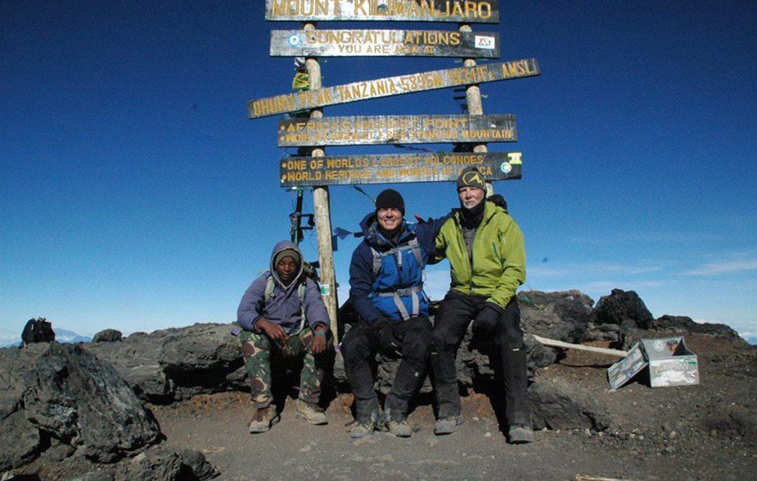 Dr. David Andereck at the peak of Mount Kilimanjaro