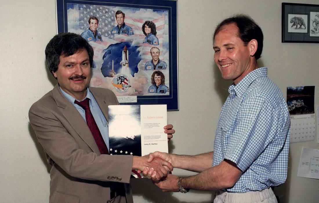 Larry Hartley receiving an award from NASA