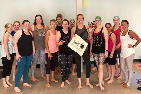 S.W.E.T. Hot Yoga team in the studio.