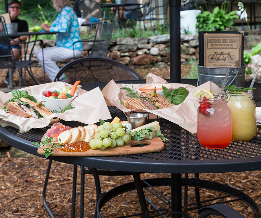 Flavor-packed offerings like the Tandem sandwich, Jamis sandwich, Carnivore board and strawberry lemonade taste even better when eaten on the back patio.