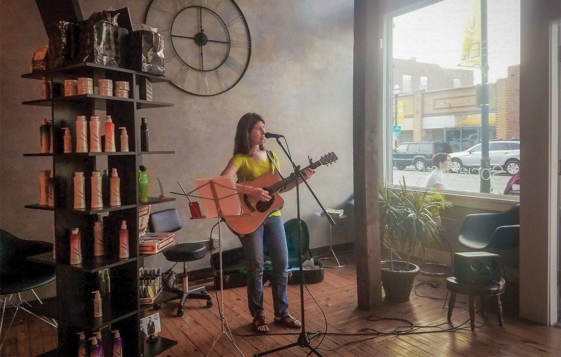 Sarah Smith plays guitar at Mane Salon and Social House