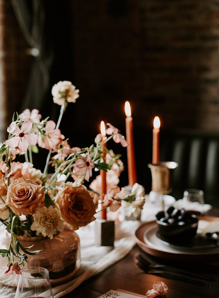Candles and table decoration in a Wildly Collective wedding design.