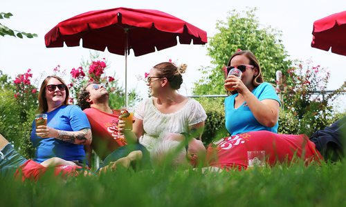 People enjoying beers in the Mother's Brewing Company backyard in Springfield MO