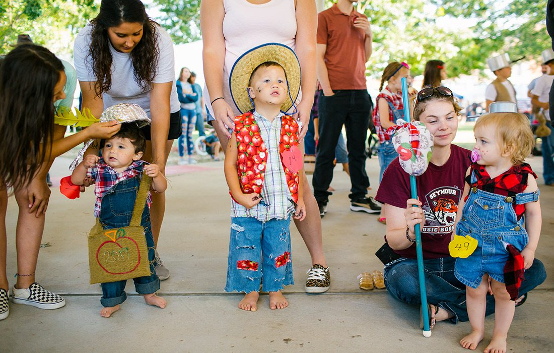Kids dressed up in costumes at a fall festival