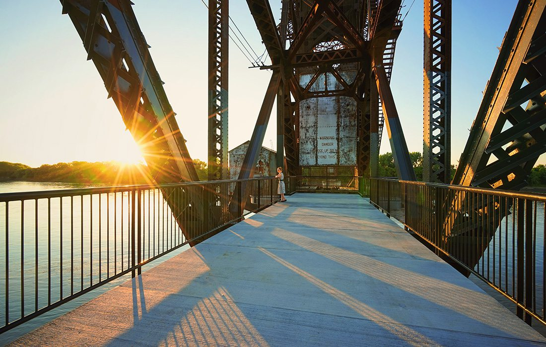 Take in the sights of the Missouri River from the Historic Katy Trail Railroad Bridge in Boonville, Missouri.