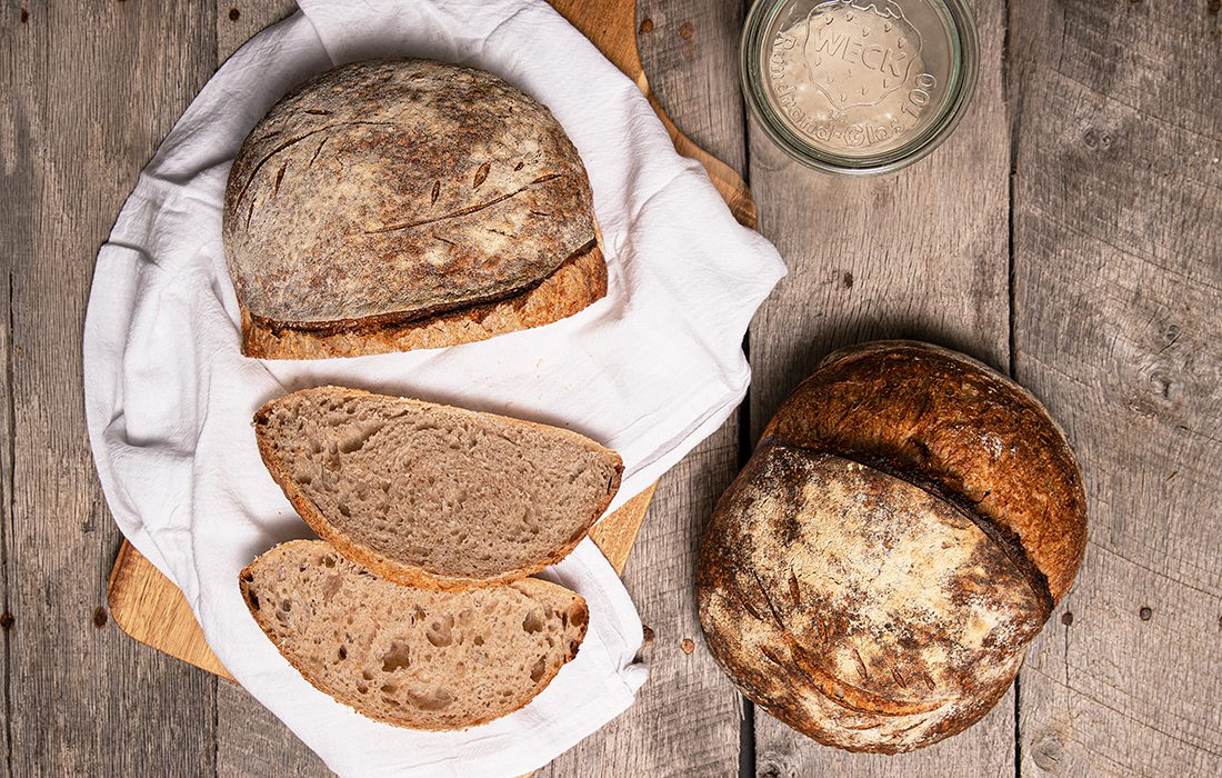 Loaves of homemade sourdough bread by Krysten Muench