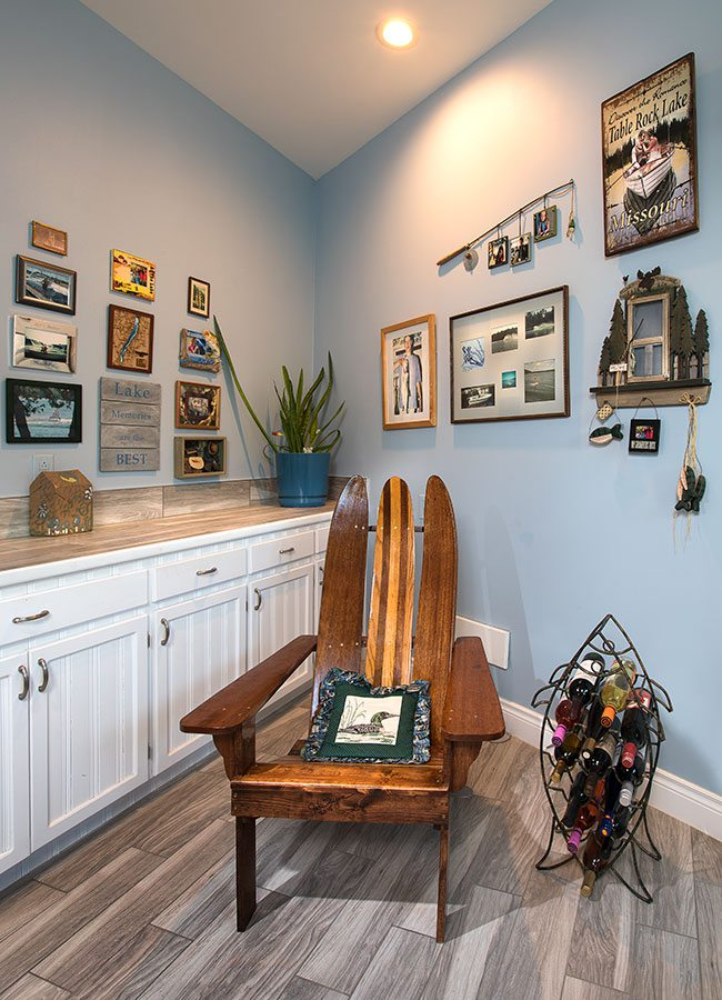Lake theme mudroom with light blue walls