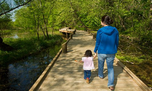 Mother and child on a trail at the Springfield Conservation Nature Center