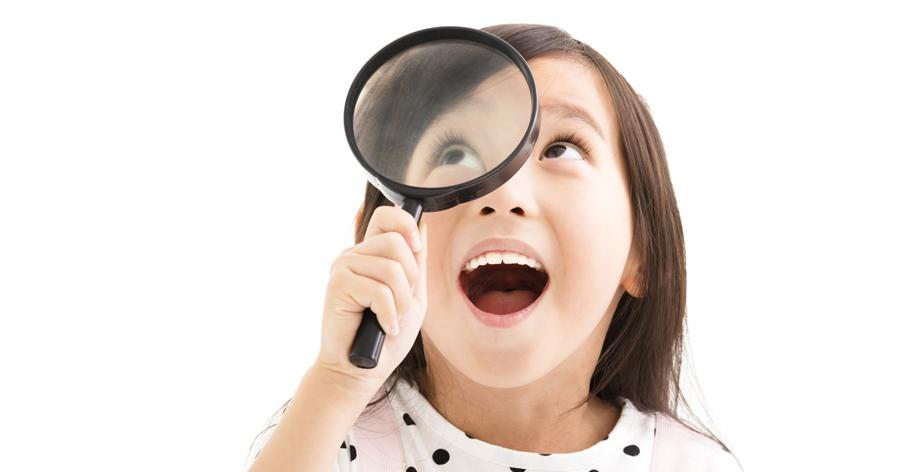 a child with a magnifying glass
