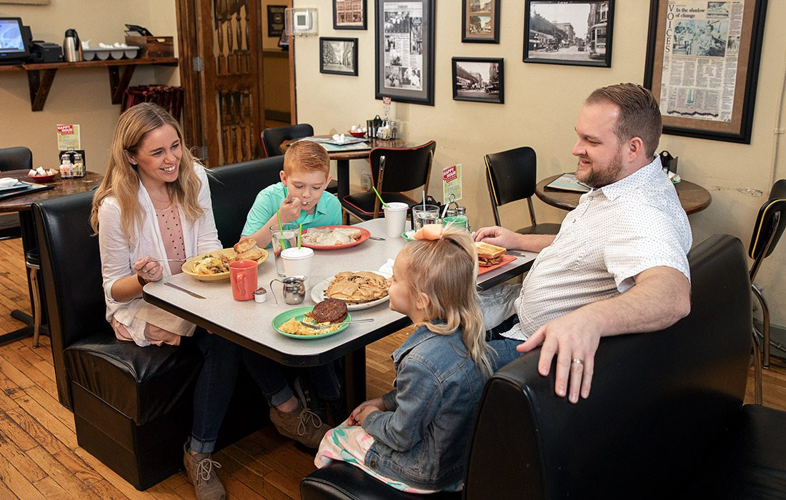 Young family eating breakfast at Gailey's in downtown Springfield MO