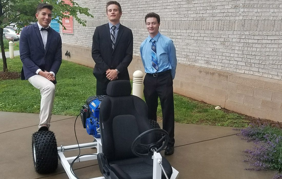 Joshua Bruce (right) and his friends designed and built a go-kart during their internship at SRC in Springfield MO