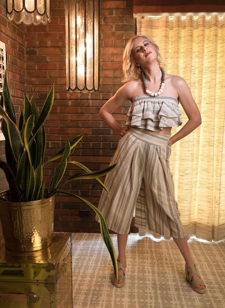 stylish women in mid-century modern home
