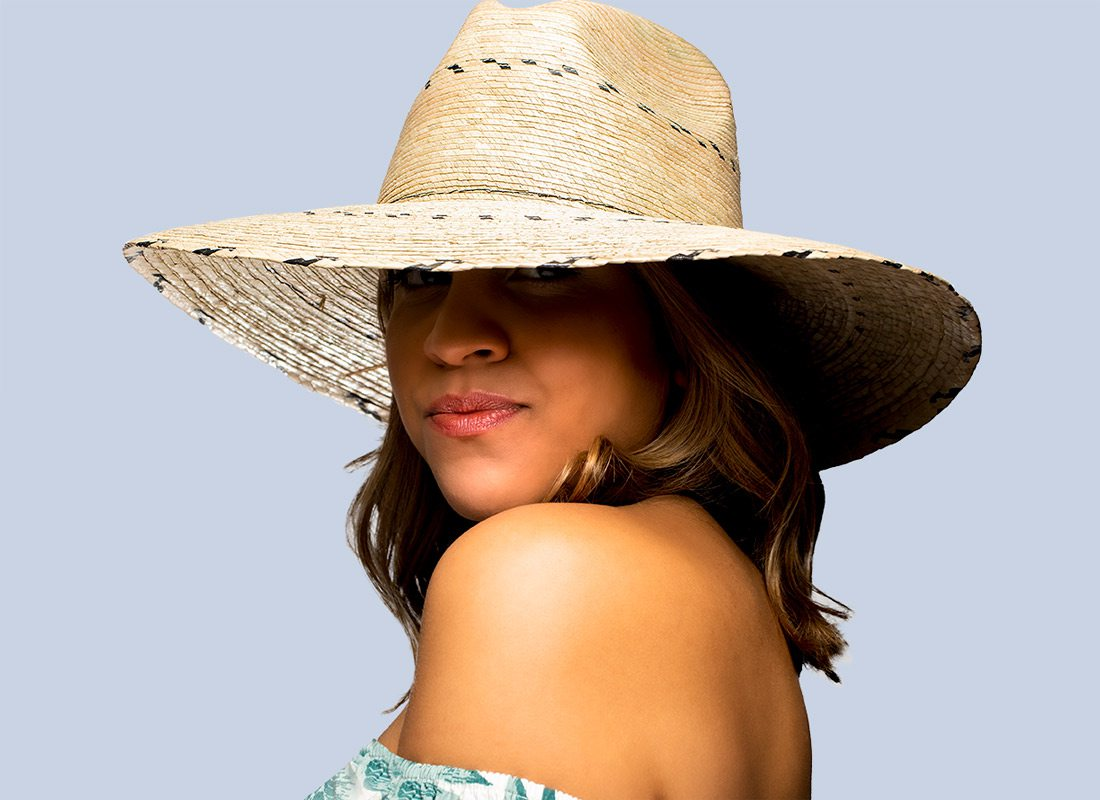 Model wearing hat from summer style photoshoot
