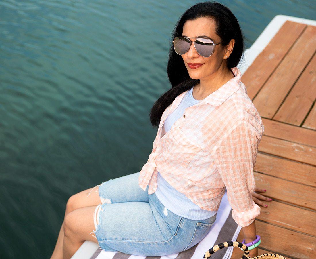 Summer style photoshoot model on the dock