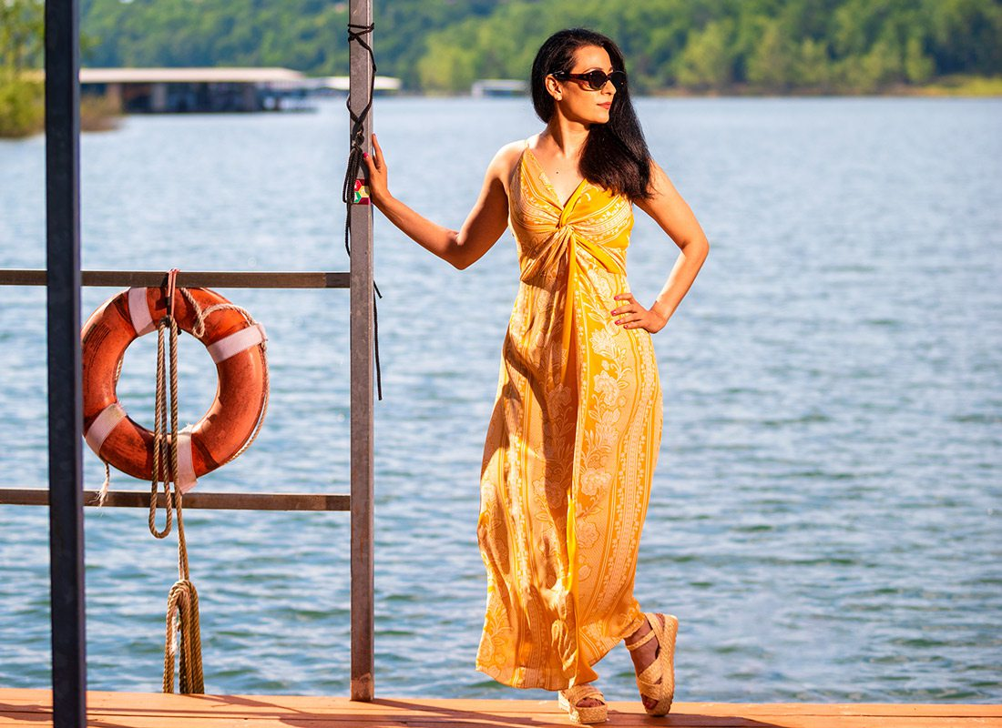Summer style model standing on the dock