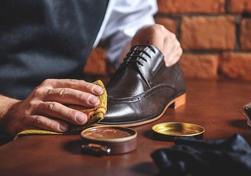 man shining a shoe