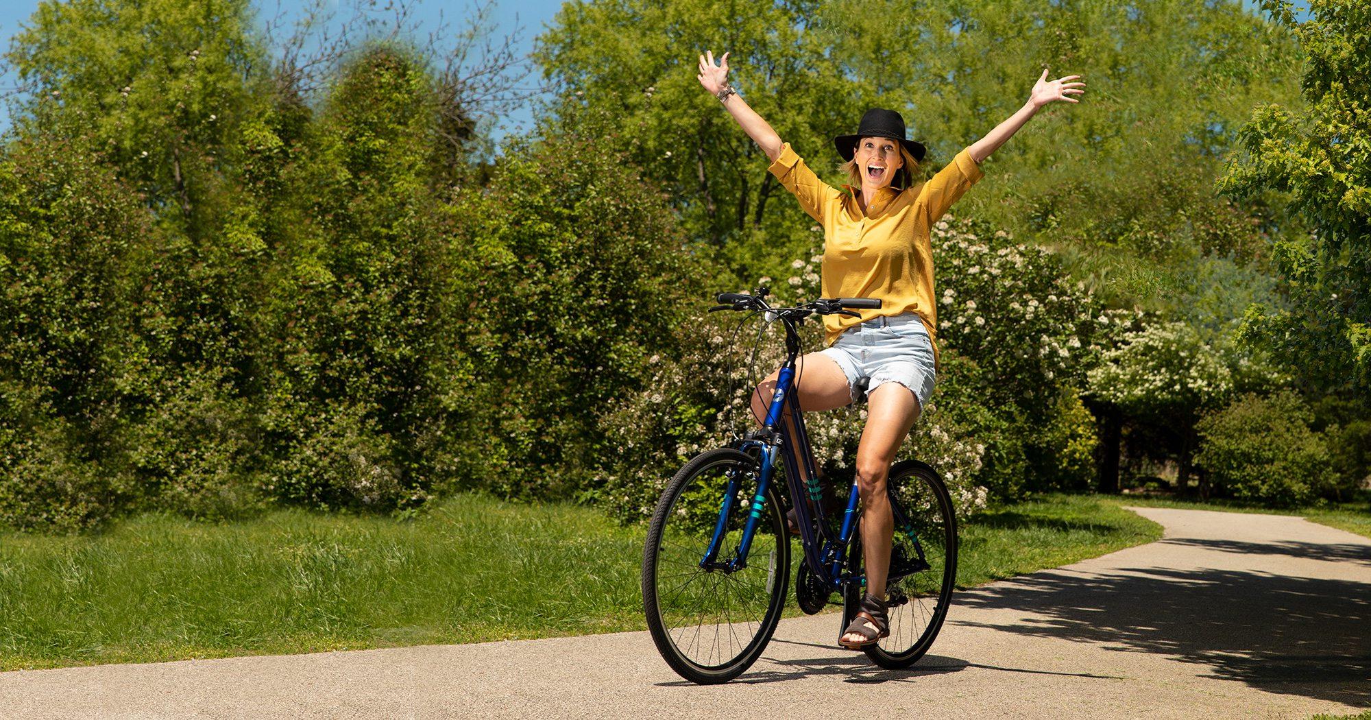 Jessica Pearson riding a bike through Nathanael Greene/Close Memorial Park in Springfield MO