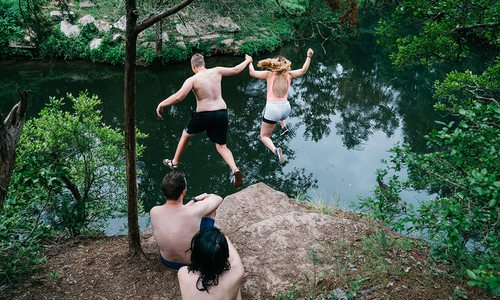 cliff jumping into water