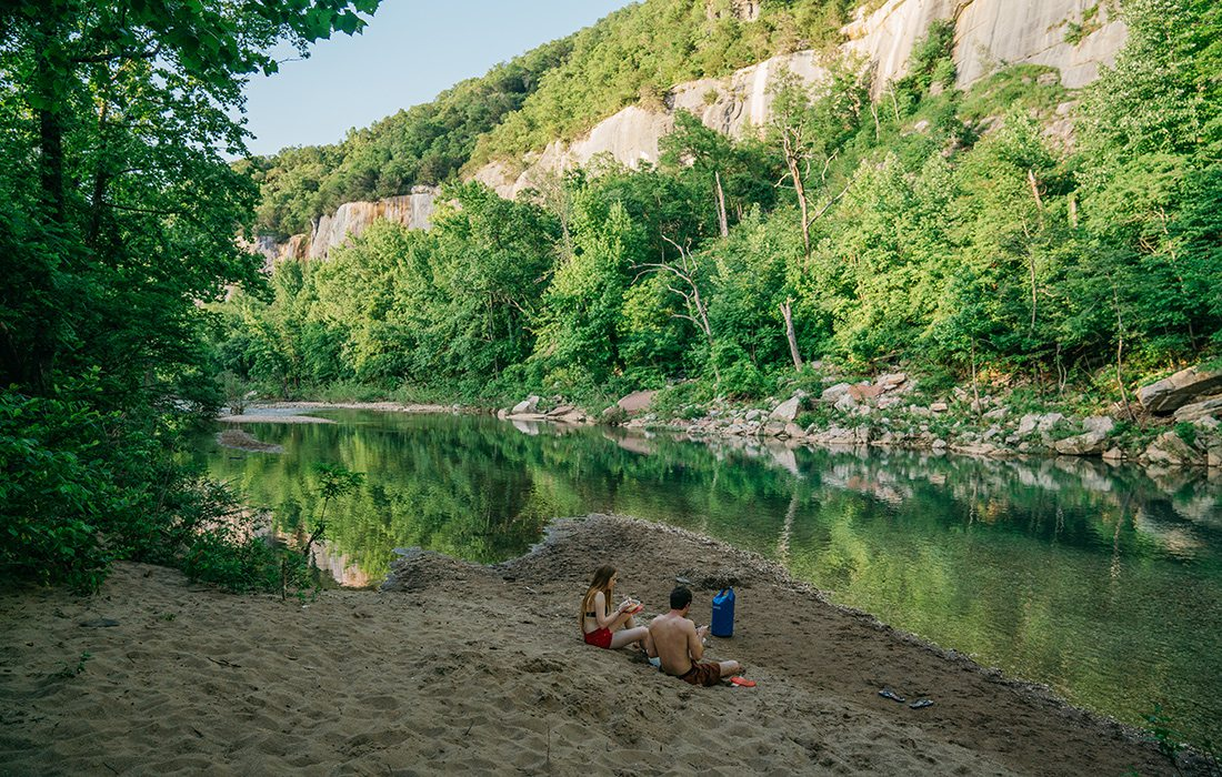 Take a break from swimming to enjoy a snack in the shade along the banks of the Buffalo River near Steel Creek Campground.
