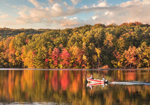 Speed boat on a lake in fall