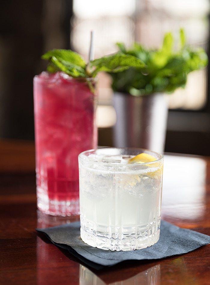The Cocchi Fizz with gin, lemon, Cocchi Bianco and elder- flower liqueur (front).