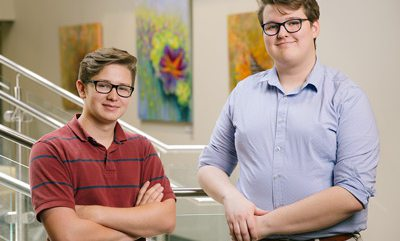 Brenden Reeves and Taylor Flores standing at staircase