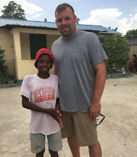 Jason Parke, owner of The Greek Corner Screen Printing and Embroidery, on a trip to Haiti with Allmade Apparel