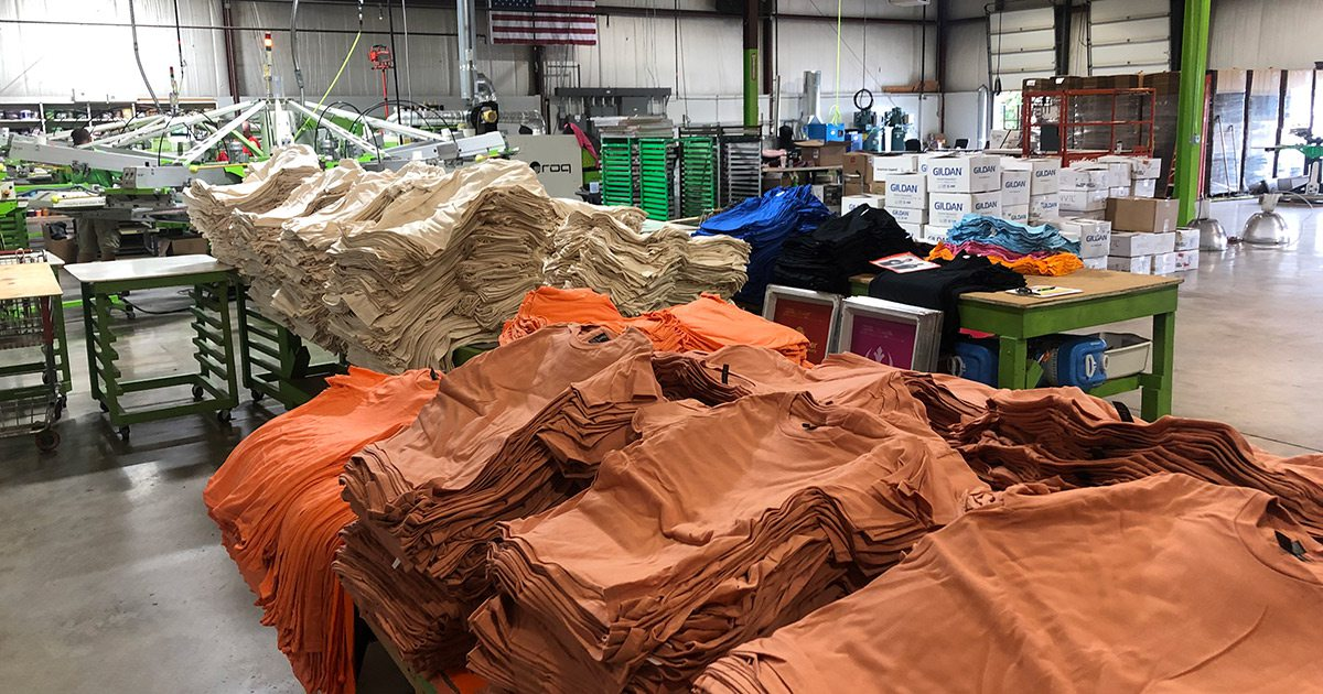 T-shirts waiting for shipping at The Greek Corner Screen Printing and Embroidery Springfield MO