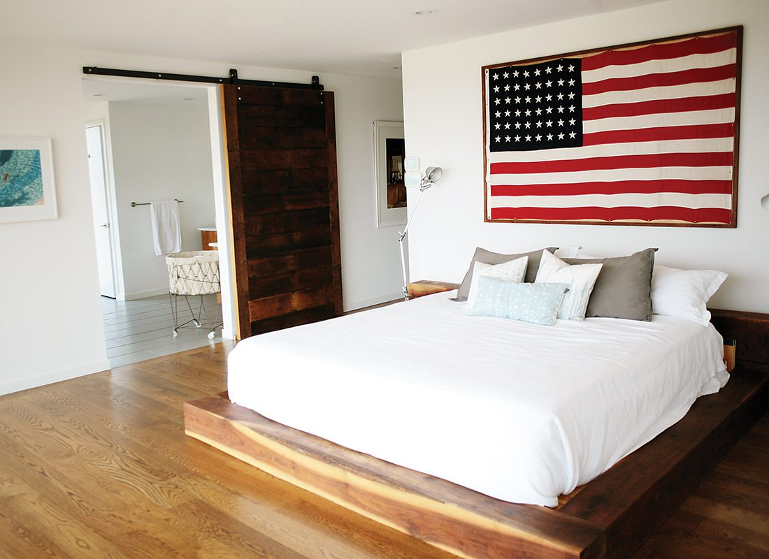 Photo By Amy PenningtonA Pivot Door Leads Into The Homeu0027s Master Bedroom  (opposite). The Bed Is Made From Milled Walnut From Hufftu0027s Farm, And A  Large Flag ...