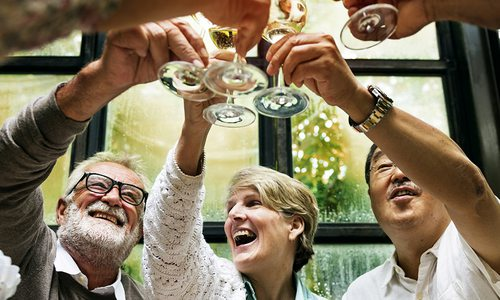 Senior friends in a retirement community enjoying a glass of wine