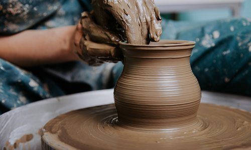 Throwing clay on a potter's wheel