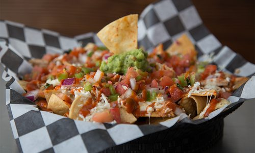 chicken nachos in a basket