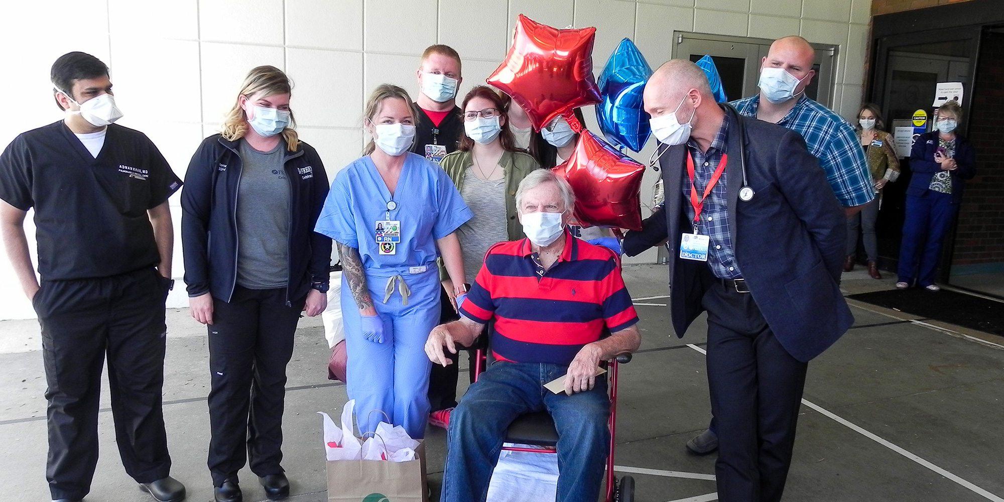 Wallace Lea, Dr. Robert McNab and Freeman Hospital staff members