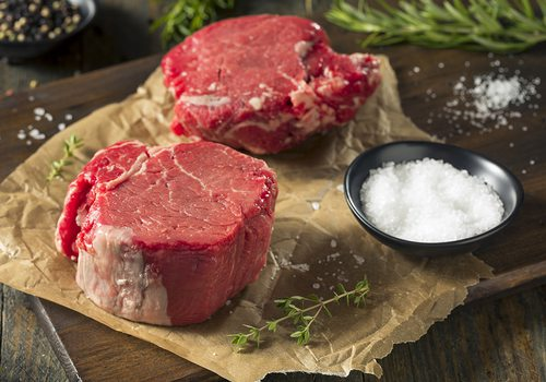 Raw filet mignon with herbs and salt