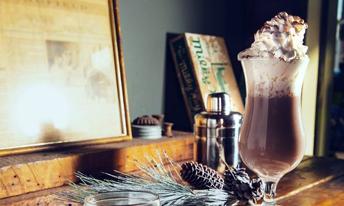 winter spice cocktail with whipped cream on top