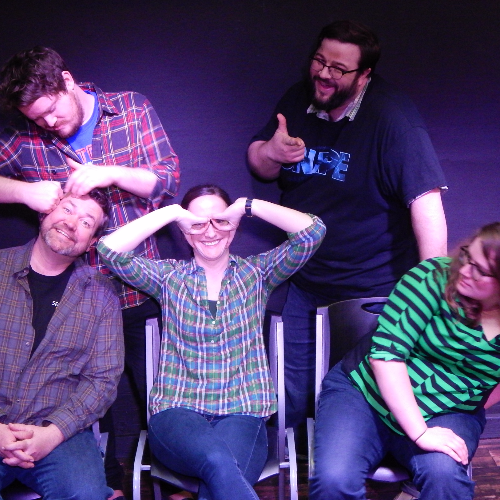 a group of comedians performing a scene