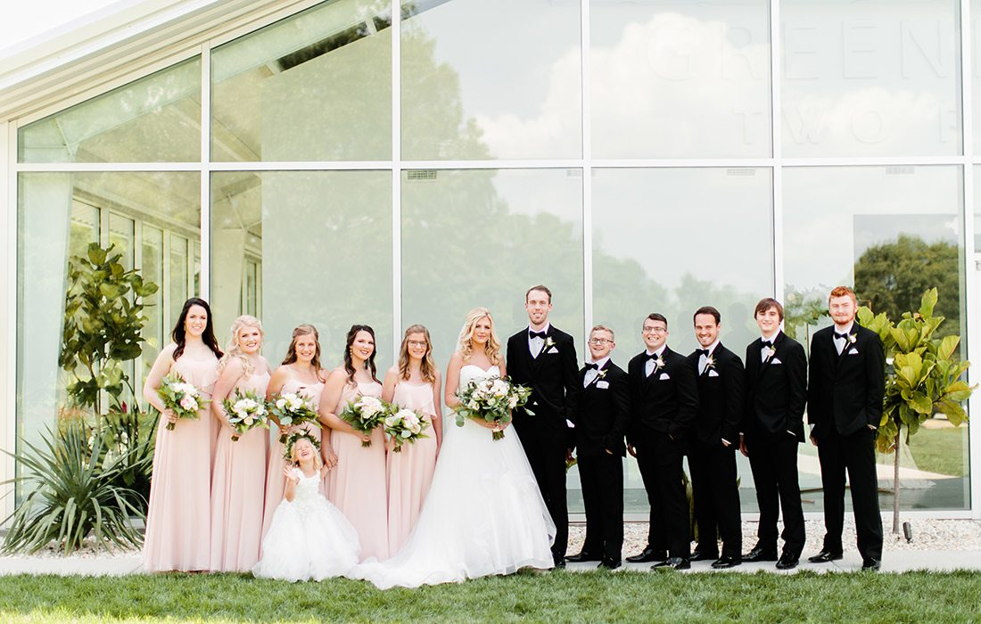 Valerie Moore & Jacob Johnson with their wedding party on their wedding day