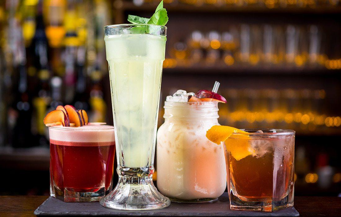 various cocktails and mocktails on a bar
