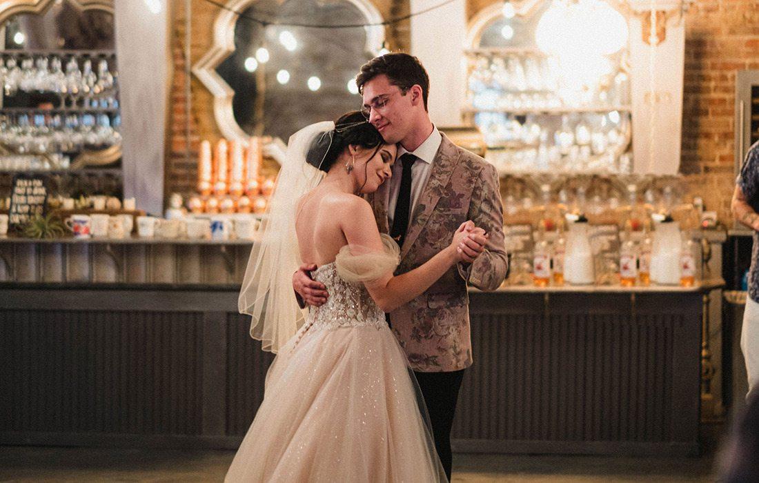 Wedding couple dancing at Venue on Brick in Ozark MO