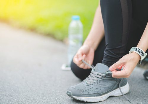 Lacing up walking shoes stock image