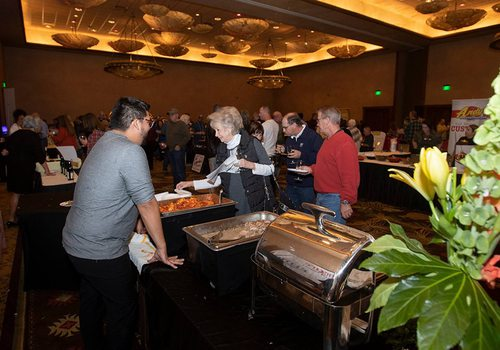 Event attendees enjoy food samples at the annual Wine & Food Celebration in Springfield MO