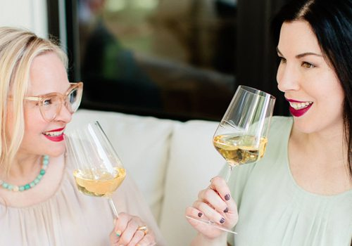 Women Sipping Wine Together