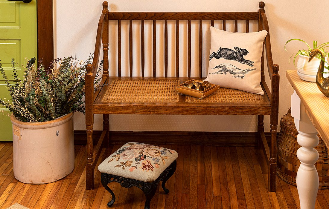 Bench with pillow and plants