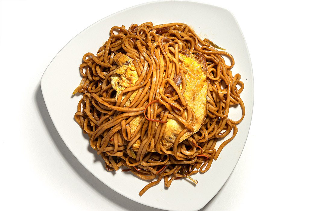 House Stir Fry Noodles on white plate